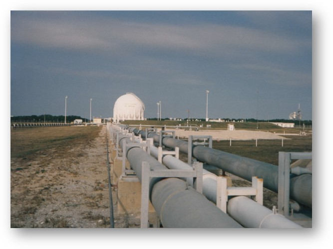A picture of the Launch Pad A Space Shuttle liquid oxygen storage sphere viewed from about mid-way to the launch pad. I took this picture during a cross country line walk down in 1996.